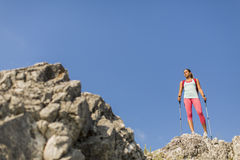 Young woman hiking on the mountain Royalty Free Stock Images