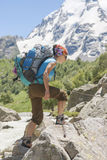 Young Woman hiking in the Mountains Royalty Free Stock Photography