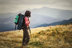 Young woman hiking on mountains with backpack Travel Lifestyle a Royalty Free Stock Photo