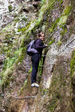 Young woman hiking  into the mountains Stock Photos