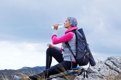 Young woman hiking in mountains Stock Images