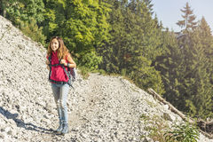 Young woman hiking on mountains in Switzerland Stock Photography