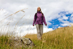 Young woman hiking in nature Royalty Free Stock Images