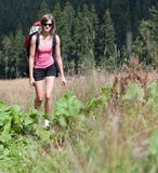 Young woman hiking outdoors Stock Image