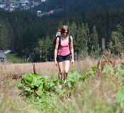Young woman hiking outdoors Stock Images