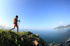 Young woman hiking on seaside mountain Royalty Free Stock Image