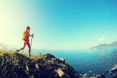 Young woman hiking on seaside mountain Royalty Free Stock Images