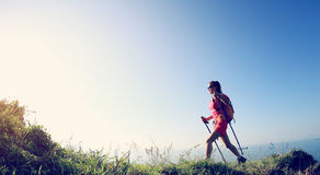 Young woman hiking on seaside mountain Stock Photos