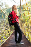 Young woman hiking in suspension bridge Royalty Free Stock Images