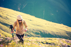 Young Woman hiking with trekking poles Travel Lifestyle concept Stock Images