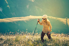 Young Woman hiking with trekking poles Travel Lifestyle concept Royalty Free Stock Photography