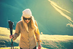 Young Woman hiking with trekking poles Travel Lifestyle concept Royalty Free Stock Images