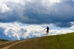 Young woman on the hill Royalty Free Stock Photography