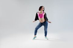 Young woman hip hop dancer, in the Studio on a Royalty Free Stock Photos