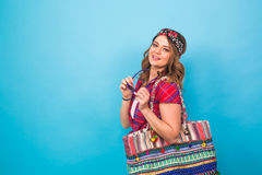 Young woman in hippie style posing at studio. Fashionable photo. Stock Photography