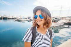 Young woman hipste traveler girl in hat on the background of a s royalty free stock photo