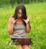 Young woman with his laptop Stock Images