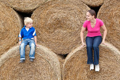 Young woman with his son on the bales Stock Photos