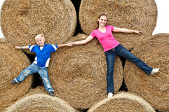 Young woman with his son on the hay bales Royalty Free Stock Photo
