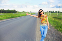 Young woman hitch-hiking Royalty Free Stock Photo
