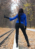 Young woman hitchhiking Royalty Free Stock Images