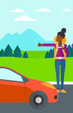 Young woman hitchhiking. Royalty Free Stock Images