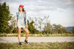 Hitchhiking on a country road Stock Photo