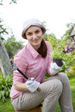 Young woman with hoe working Royalty Free Stock Photo