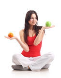 Young woman hold apple and orange. Isolated Royalty Free Stock Photo