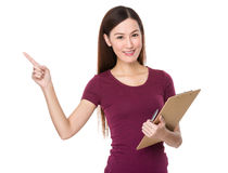 Young woman hold with clipboard and finger point up Stock Photos