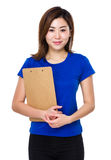 Young woman hold with clipboard Royalty Free Stock Photos