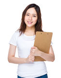 Young woman hold with clipboard Royalty Free Stock Images