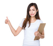 Young woman hold with clipboard and thumb up Royalty Free Stock Photo