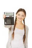 Young woman hold digital calculator. Stock Image