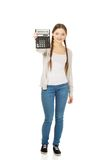 Young woman hold digital calculator. Royalty Free Stock Photo