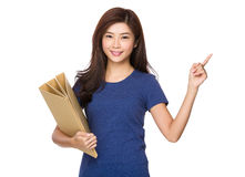Young woman hold with folder and finger pointing up Royalty Free Stock Photography