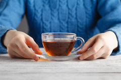 Young woman hold glass cup oа tea on table Royalty Free Stock Photos
