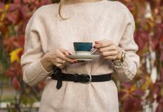 Tea cup with tea in woman hand stock photos
