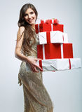 Young woman hold many red, white gift box . Female model isolat Royalty Free Stock Photography