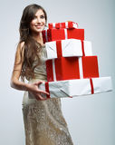 Young woman hold many red, white gift box . Female Royalty Free Stock Photos