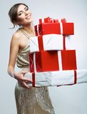 Young woman hold many red, white gift box . Female model isolat Royalty Free Stock Photo
