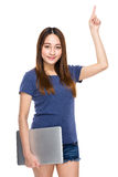 Young woman hold notebook computer with finger up Stock Photography