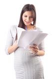 Young woman hold pages of paper. Paperworker Royalty Free Stock Photography