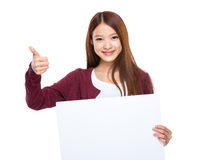 Young woman hold placard and thumb up Royalty Free Stock Image