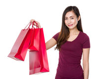 Young woman hold with shopping bag Stock Images