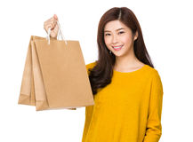 Young woman hold with shopping bag Stock Photography
