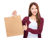 Young Woman hold with shopping bag and thumb up Royalty Free Stock Photography