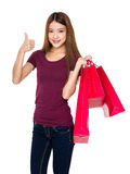 Young woman hold with shopping bag and thumb up Royalty Free Stock Images