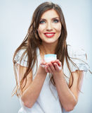 Young woman hold skin care cosmetic. Clean skin. Beauty female Royalty Free Stock Images