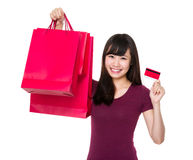 Young woman hold up with shopping bag and credit card Stock Image